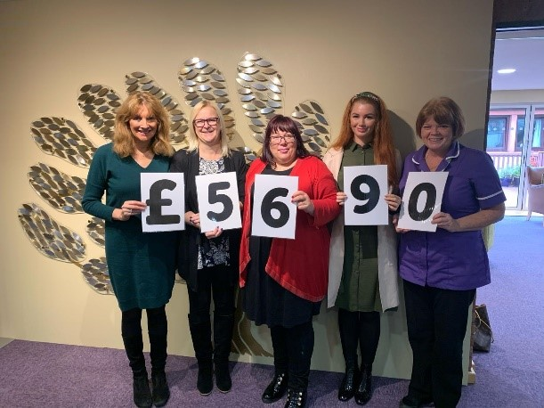 Award-winning financial services provider raises thousands for charity